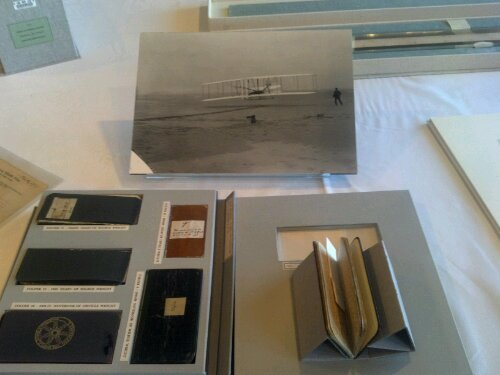 The collections of the Wright Brothers, their notes, and the image of their first flight.